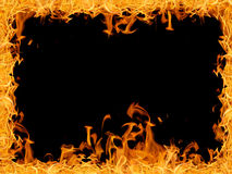 Yellow bright large fire frame isolated on black Royalty Free Stock Image