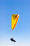 Yellow bright Paraglider in blue sky. Yellow Paraglider in blue sky Royalty Free Stock Photography
