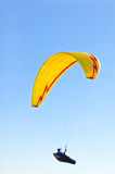 Yellow bright Paraglider in blue sky. Yellow Paraglider in blue sky Stock Images