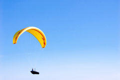 Yellow bright Paraglider in blue sky. Paraglider in blue sky. Sport and hobby Stock Photo