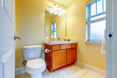 Yellow bright small bathroom Royalty Free Stock Image