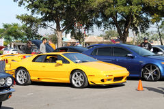 Yellow British sports car. Exotic British sports car parked next to other cars and people walking around. Yellow Lotus Esprit by Giugiaro in Miami, Florida 2015 Royalty Free Stock Image