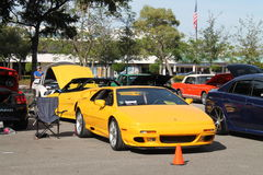 Yellow British sports car. Exotic British sports car parked next to other cars and people walking around. Yellow Lotus Esprit by Giugiaro in Miami, Florida 2015 Stock Photo