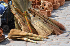 Yellow brooms. Some wattle brooms on Vyborg market. Russia royalty free stock photo