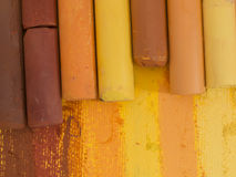 Yellow and brown artistic crayons royalty free stock images