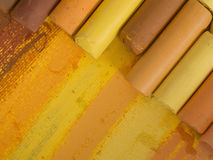 Yellow and brown artistic crayons Stock Photos