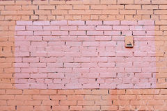 Yellow and brown brick wall with painted splotch Stock Photo
