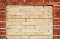 Yellow brown brick wall with red brick wall in border, space for text. A Yellow brown brick wall with red brick wall in border, space for text royalty free stock image