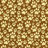 Yellow and Brown Doggy Paw Print Tile Pattern Repeat Background Royalty Free Stock Photos
