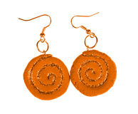Yellow-brown earrings with sequins. spiral Royalty Free Stock Images
