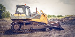 Yellow and Brown Metal Pay Loader on He Dirt Stock Photo