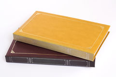 Yellow & Brown Photo Albums. Yellow and brown photo albums with blank fronts for writing on Stock Image