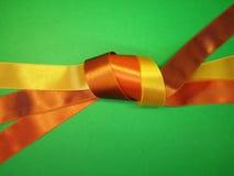 Yellow and brown ribbon Stock Photos
