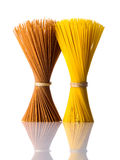 Yellow and Brown Spaghetti Isolated on White Background Royalty Free Stock Image