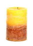 Yellow and brown wax candle Stock Photography
