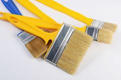 The yellow brush for painting paint Stock Images