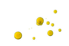 Yellow bubbles. Yellow air bubbles is isolated over a white background Royalty Free Stock Photo