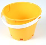 Yellow bucket 1. Isolated typical yellow plastic bucket Royalty Free Stock Photos