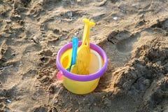 Yellow bucket. A child plastic bucket on beach backlit near sundown Royalty Free Stock Photo