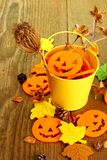 Yellow bucket with Halloween and autumn deco Royalty Free Stock Photo
