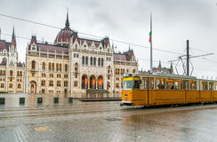 Yellow Budapest tram in front of Hungarian National Parliament Stock Photography