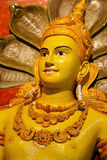 Yellow Buddha and snakes Stock Photography