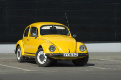Yellow bug. Car stay in the parking place stock photography