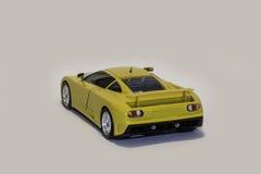 Yellow Bugatti EB 110. Back view of a yellow Bugatti EB 110 model car isolated Royalty Free Stock Images