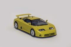 Yellow Bugatti EB 110. Front view of a yellow Bugatti EB 110 model car isolated Stock Photography