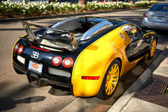 Yellow Bugatti Veyron on Rodeo Drive of Beverly Hills. Royalty Free Stock Photo