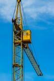 Yellow building crane under blue sky Stock Image
