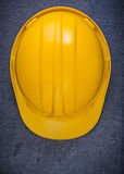 Yellow building helmet on black background construction concept Royalty Free Stock Photos