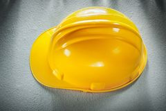 Yellow building helmet on concrete background top view.  Royalty Free Stock Photo