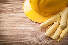 Yellow building helmet protective gloves on wooden board constru Royalty Free Stock Photography