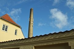 Yellow building and a large chimney Royalty Free Stock Photography