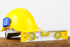 Yellow building level. On the old wood table Stock Photo