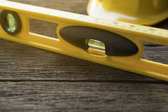Yellow building levels on old wood table Stock Image