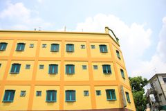 a yellow building in singapore royalty free stock images