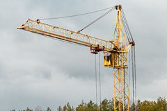 Yellow building tower crane Royalty Free Stock Image