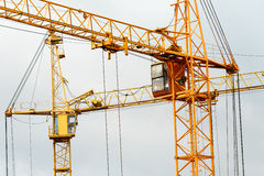 Yellow building tower crane Stock Photo