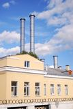 Yellow building with tubes. Moscow city center. Yellow building with tubes. Blue sky with clouds. Moscow city industrial cityscape royalty free stock photos