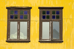 Yellow building and windows Royalty Free Stock Image