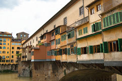 Yellow builds with green shutters in Florence, Italy stock photography