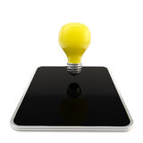 Yellow bulb above the pad screen Royalty Free Stock Image