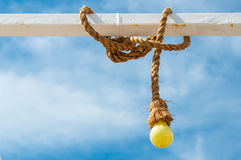 Yellow bulb with rope Royalty Free Stock Images