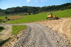 Yellow bulldozer. Photo of the yellow bulldozer on the timber line - Beskid mountains Stock Image
