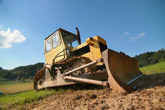 Yellow bulldozer. Photo of the yellow bulldozer on the timber line - Beskid mountains Stock Photos