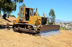 Yellow bulldozer, Andalusia, Spain. Royalty Free Stock Photography