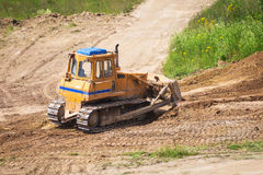 Yellow bulldozer with caterpillar Royalty Free Stock Photography