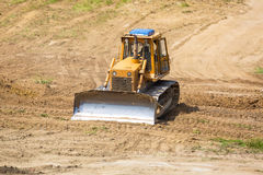 Yellow bulldozer with caterpillar Royalty Free Stock Images